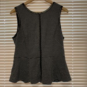 Sleeveless black and white peplum top